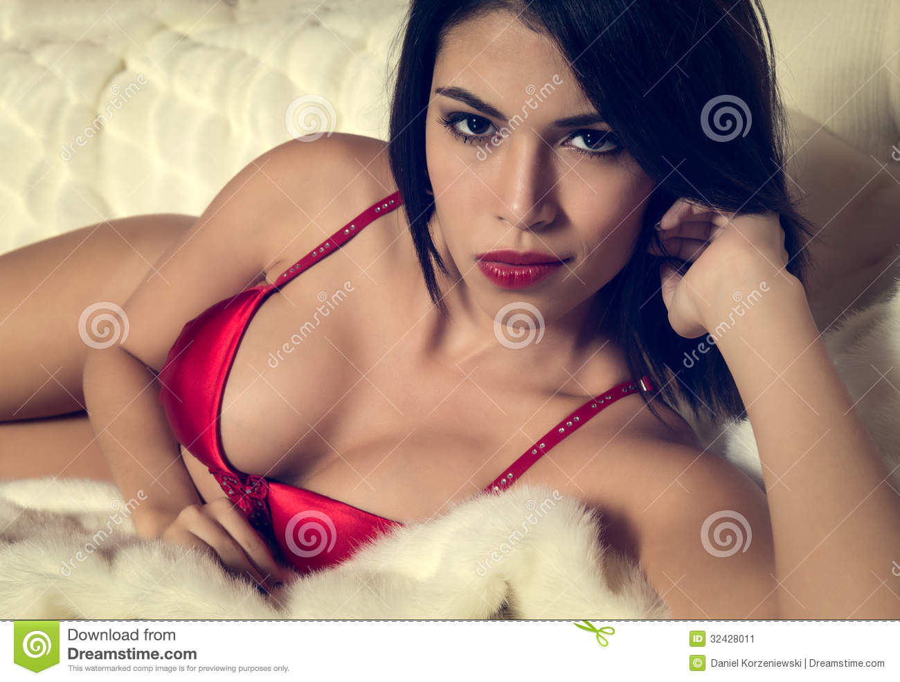 ef5da821782 voluptuous brunette woman in red lingerie lying on her bed looking at the  camera with a seductive sultry look while pouting her red lips.
