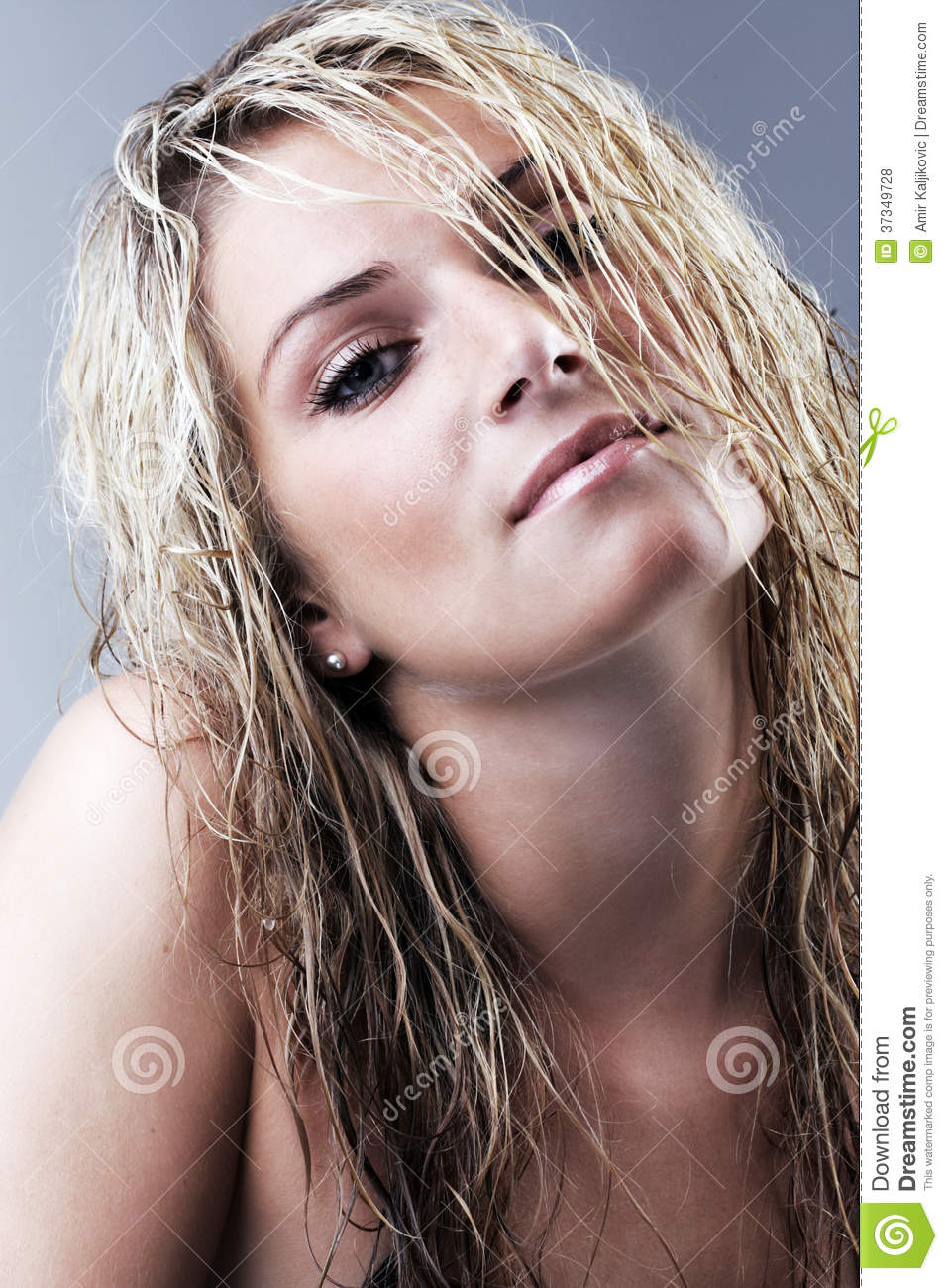 Seductive beautiful blond with long wet hair