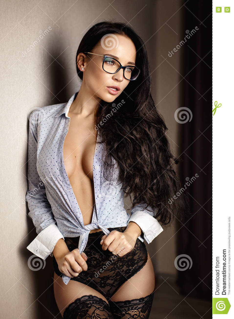 Seductive secretary girl in a glasses