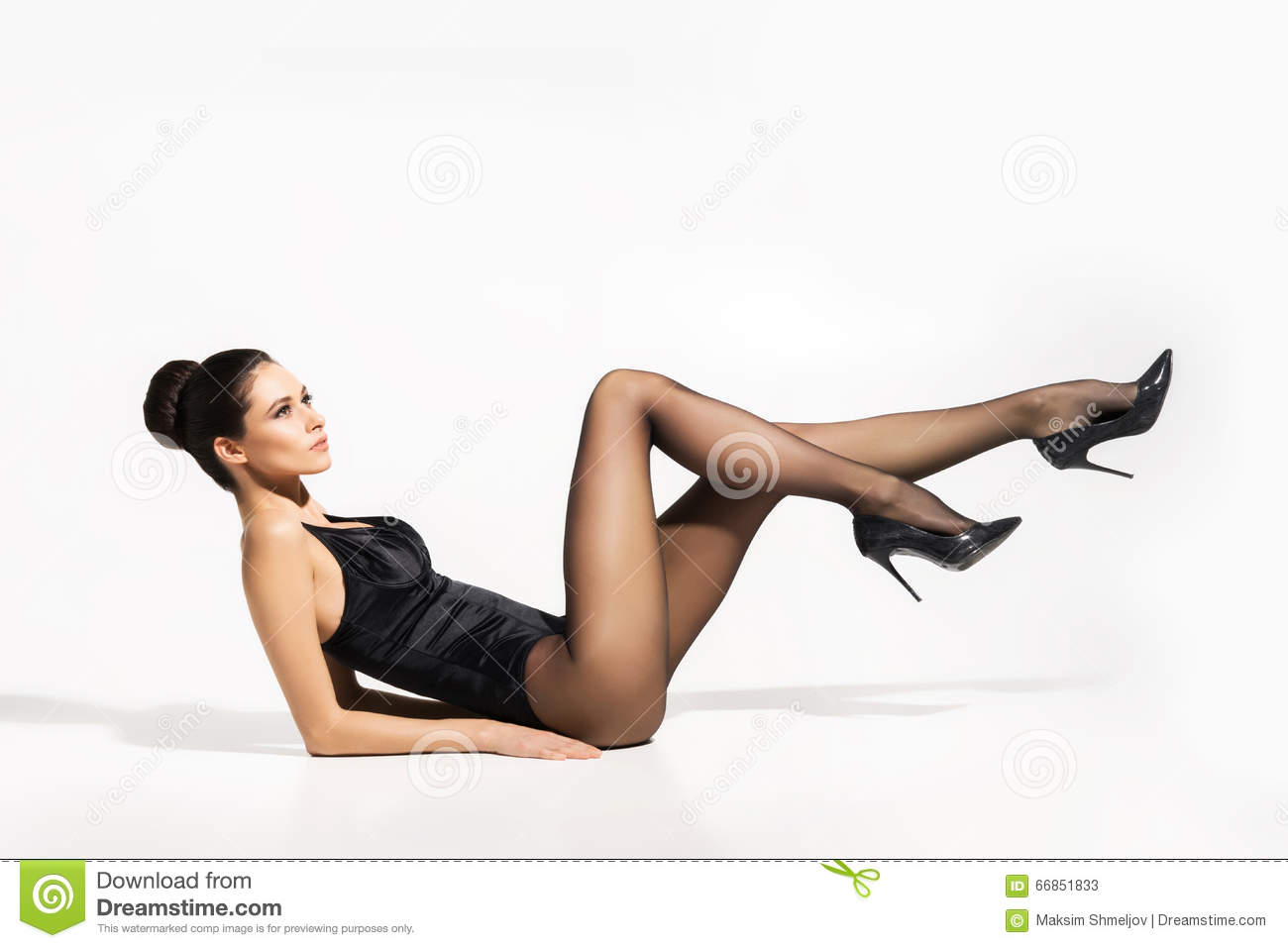Seductive Woman Wearing Pantyhose And Heels With Sexy Legs