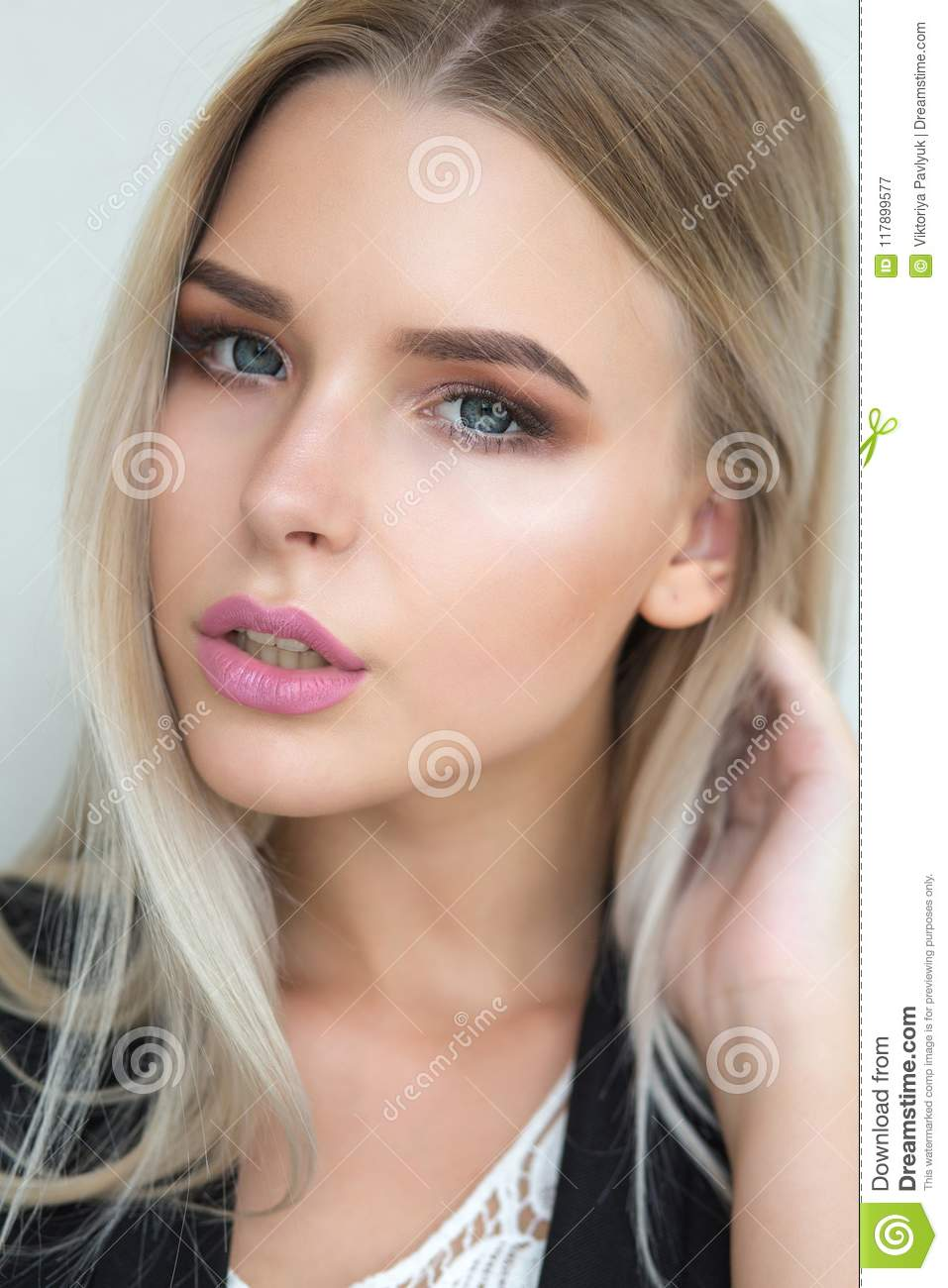 ff4ae4c7962 Seductive young blonde model with natural makeup and long straight hair