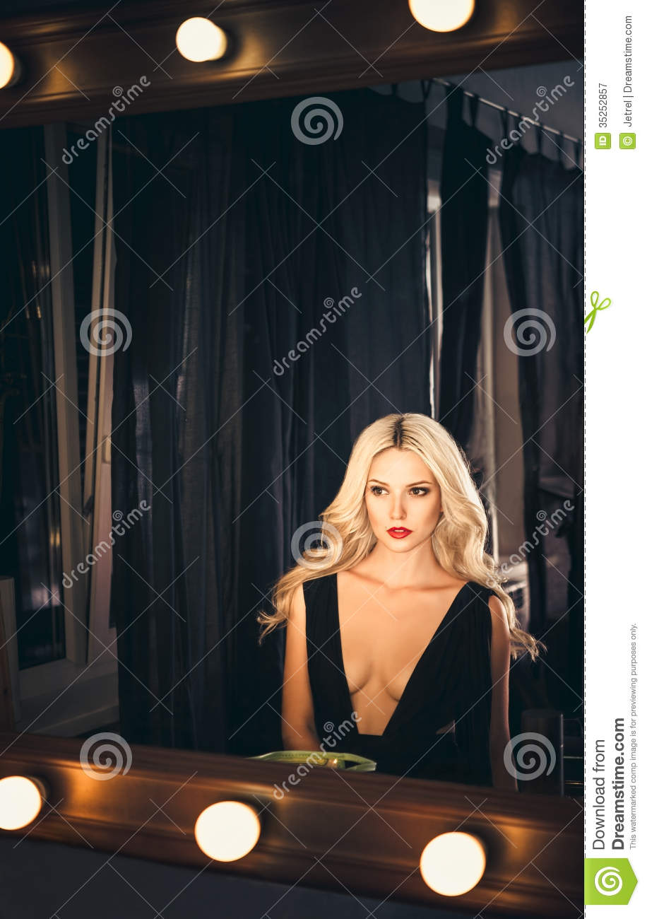 Seductive young girl looking into mirror stock image for Looking mirror