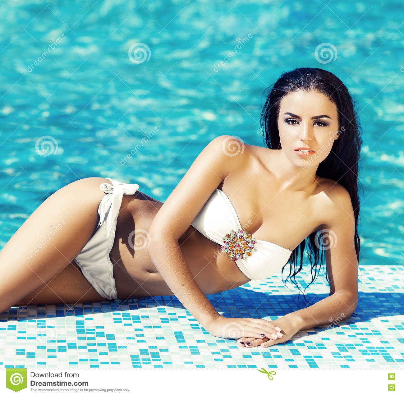 6d9ba7f646c80 Seductive Young Woman In A Swimsuit Posing Next To A Pool Stock ...