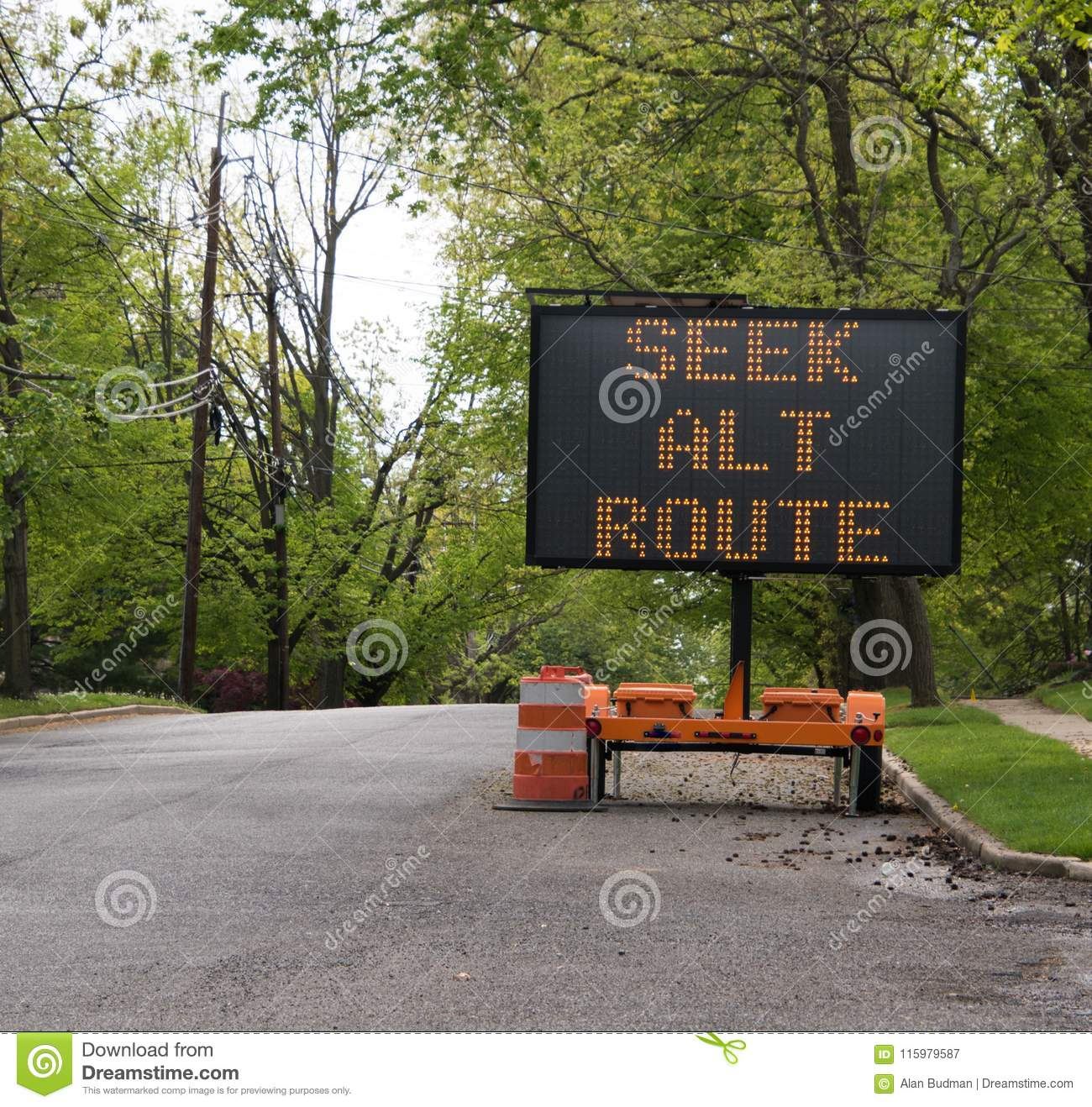Seek alternate route LED sign on tree lined road