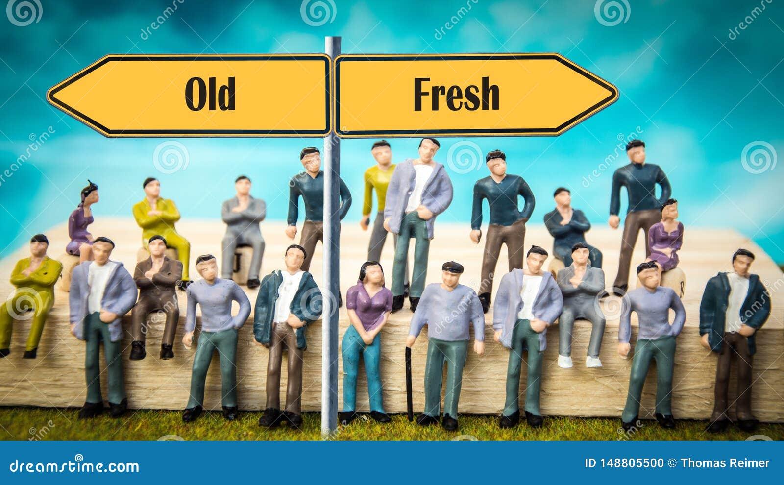 Segnale stradale fresco contro vecchio