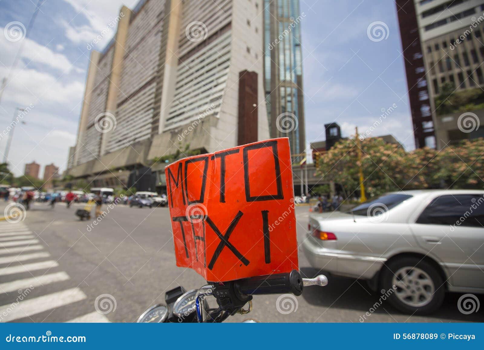 Segno che sta su una motocicletta, Caracas del taxi di Moto