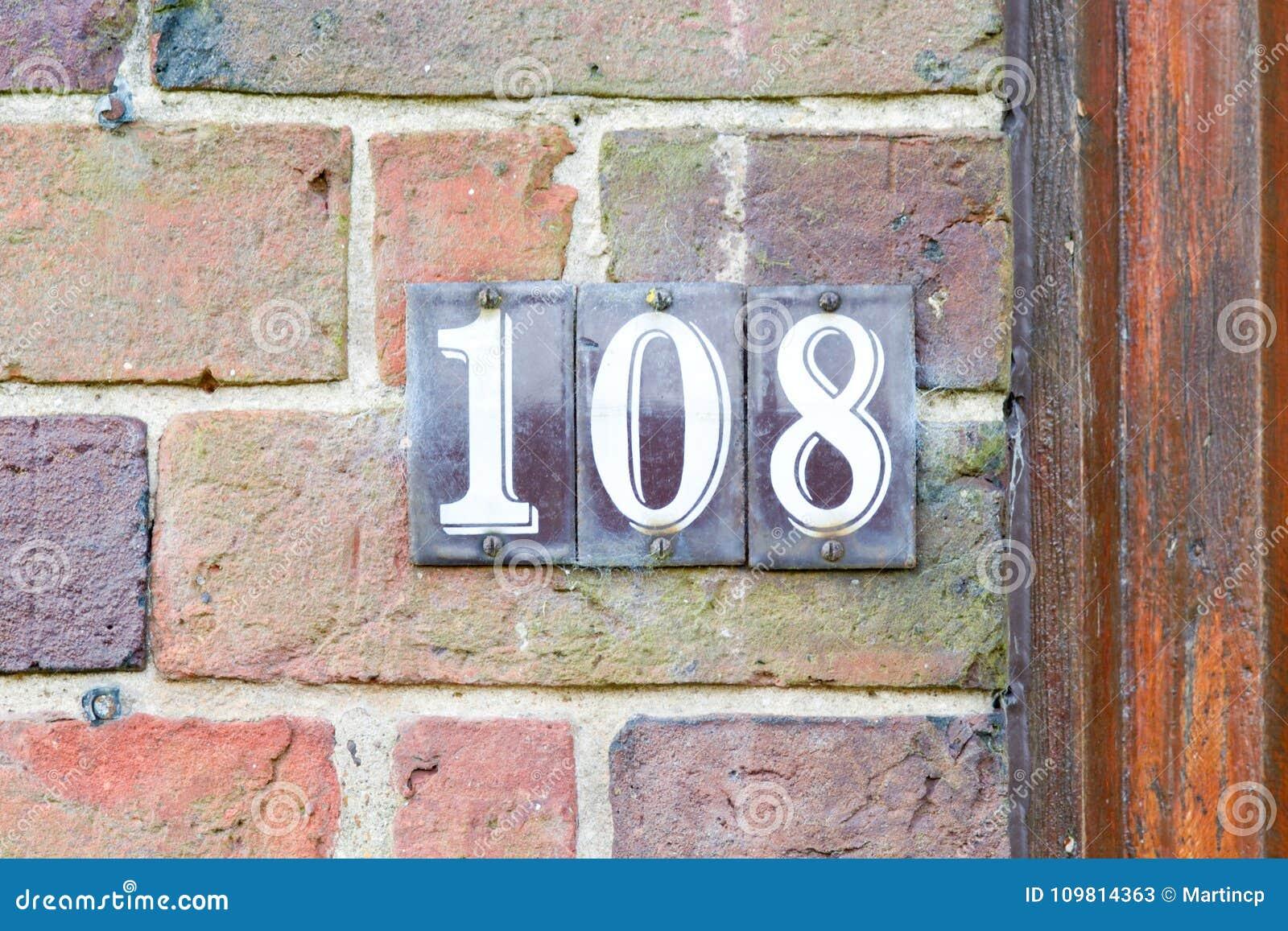 Segno del numero civico immagine stock immagine di fissato