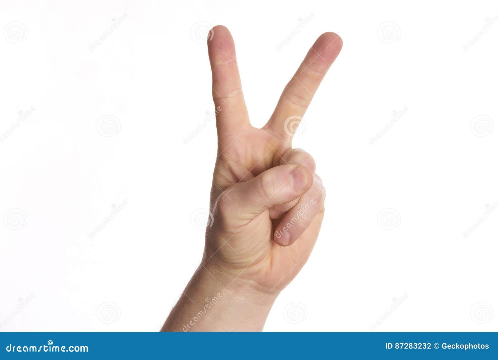 Segno di pace di gesto di mano su bianco dell isolato