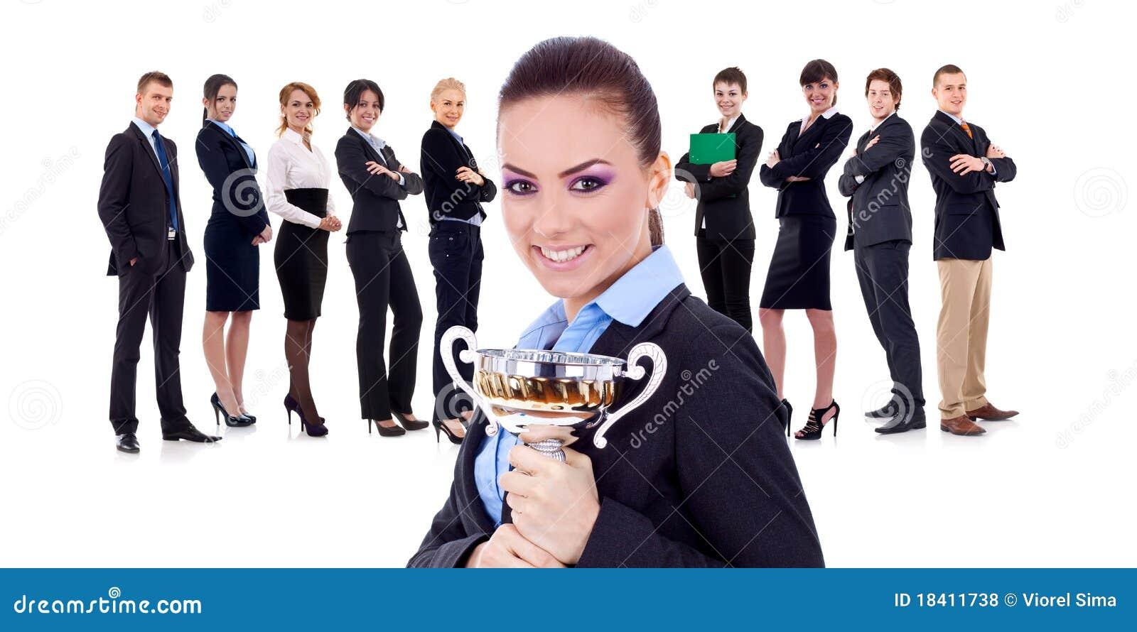 Segra för trofé för businessteamkvinnligholding