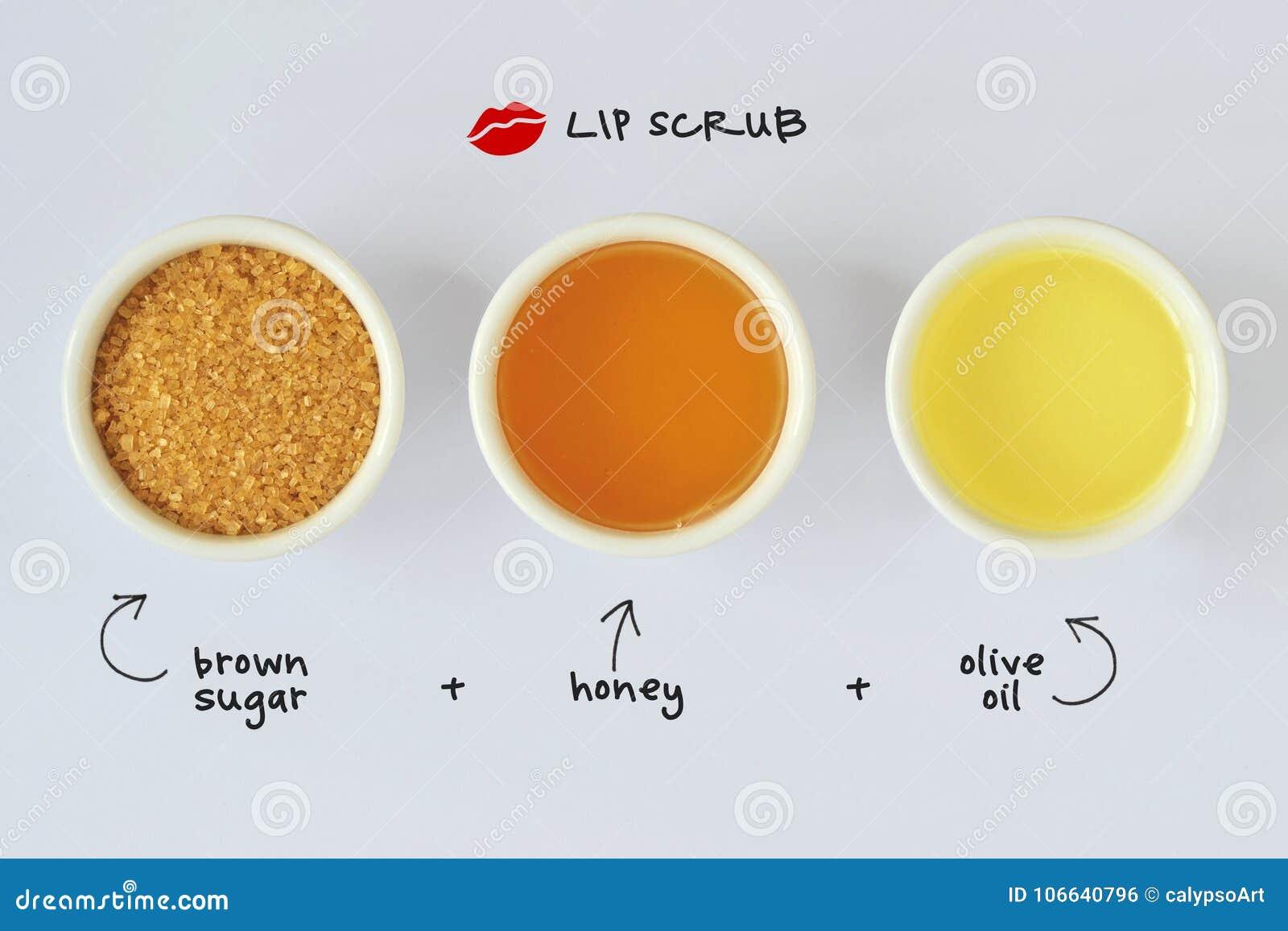 Selbst gemachte Lippe scheuern sich gemacht aus braunem Zucker, Honig und Olivenöl heraus