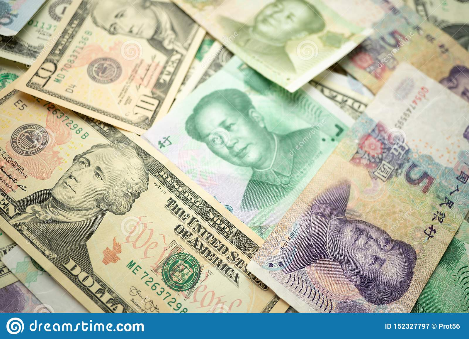 Select focus of 10 US dollar stack under China yuan banknote. Concept of Trade war between the United States and China