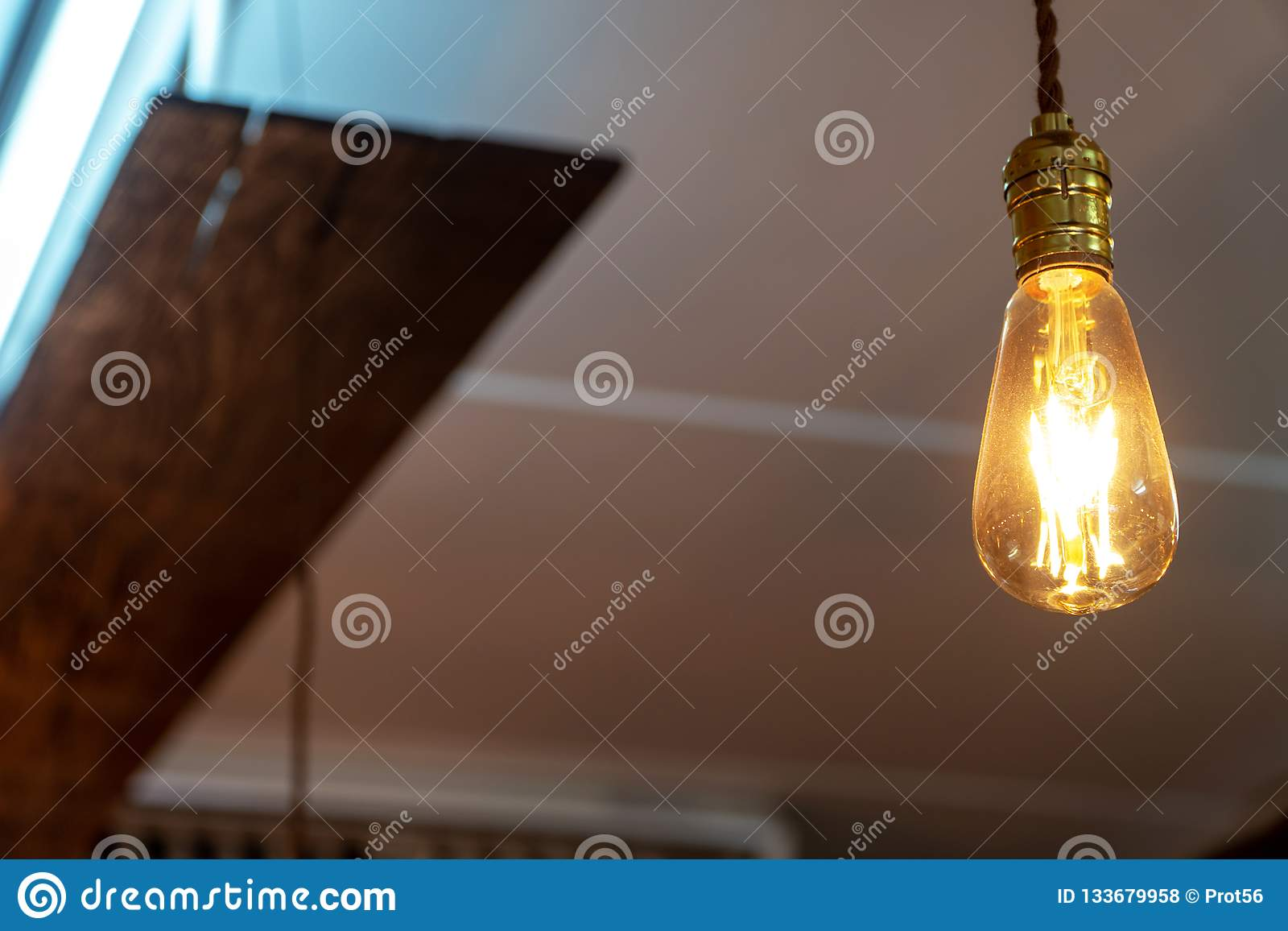 Select focus of vintage lamp decoration in coffee shop