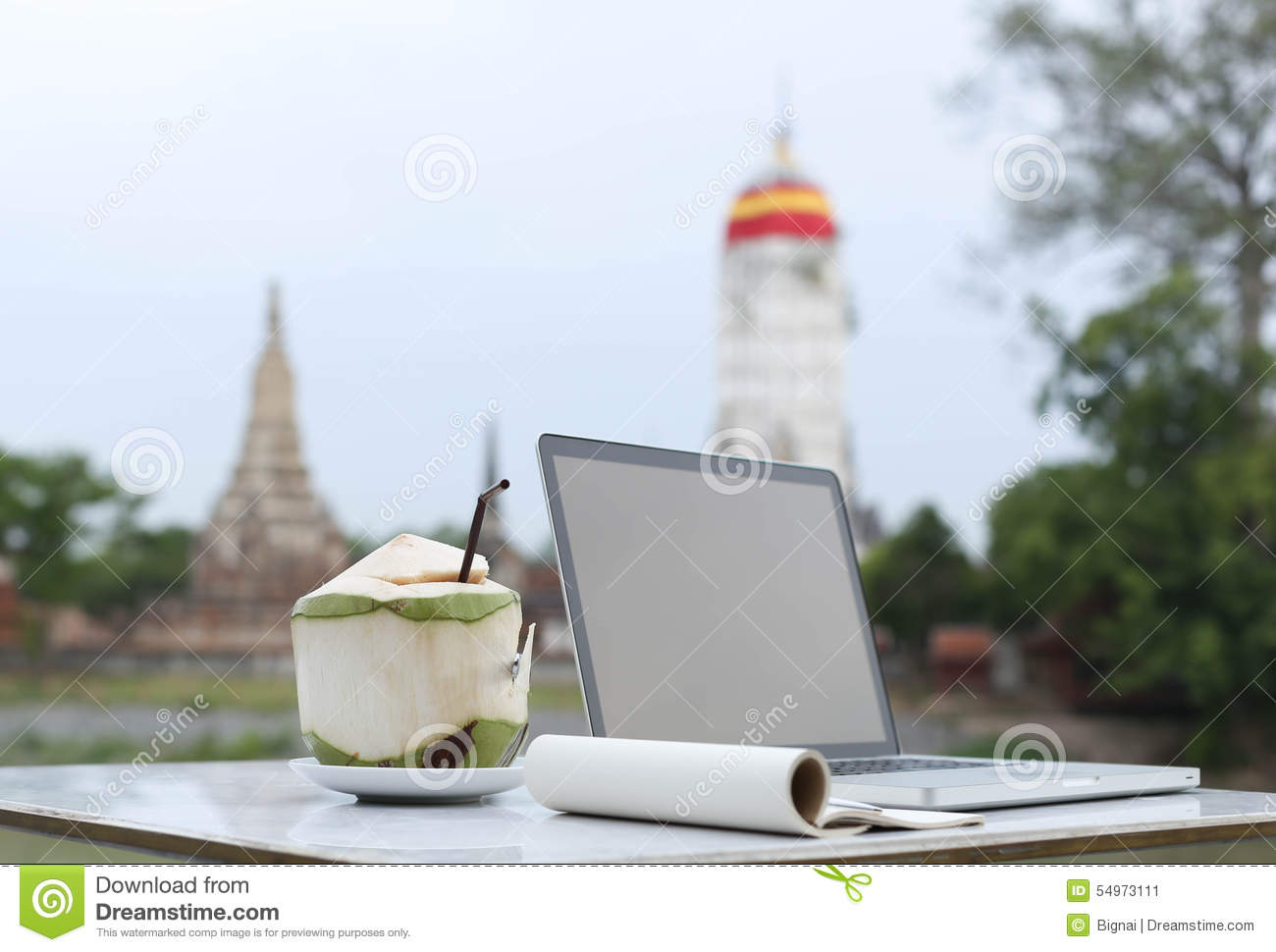 Selected focus and coconut drink with Blank notepad