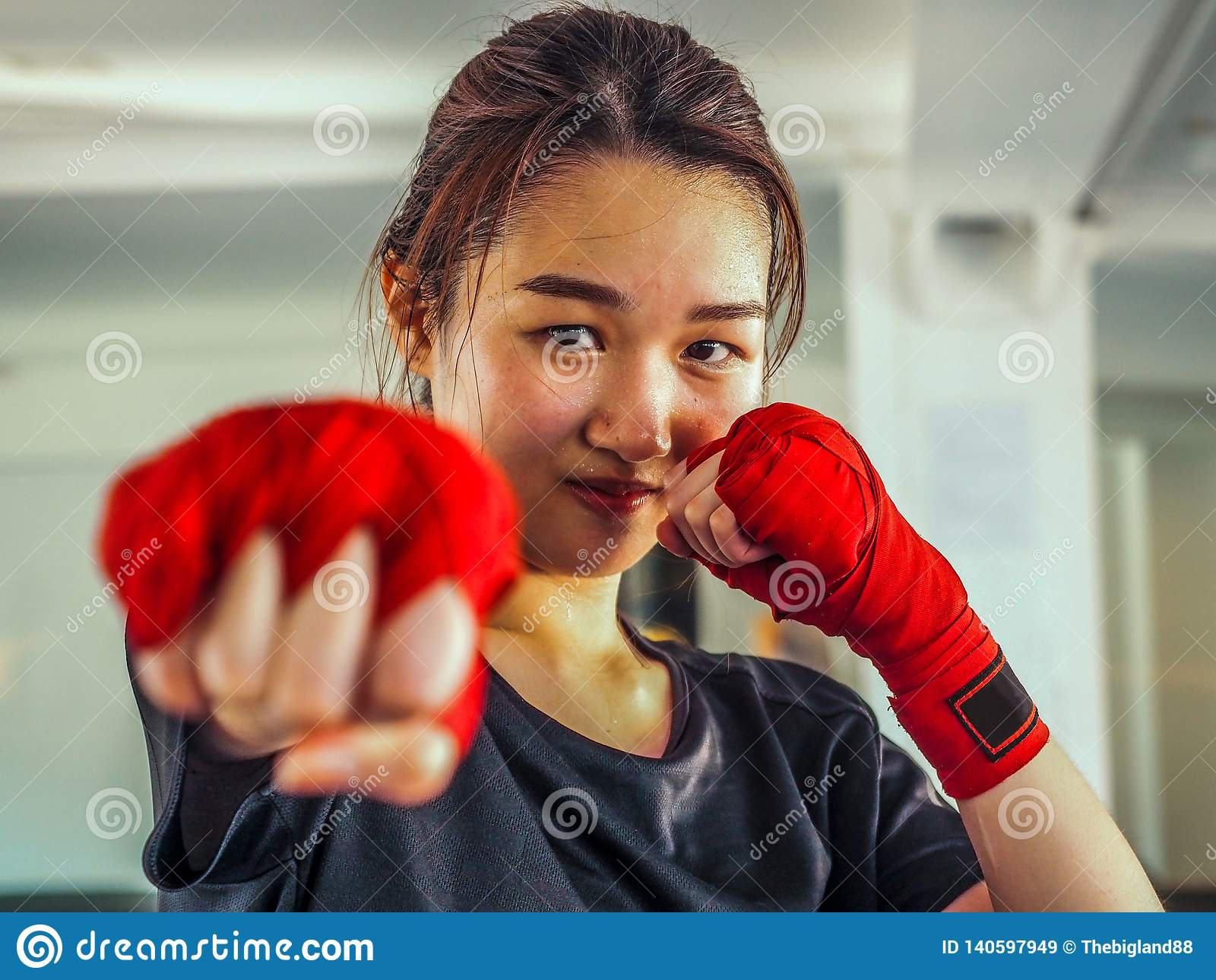 Selected focus of young beautiful women wear a red Thai boxing tape ready for punching