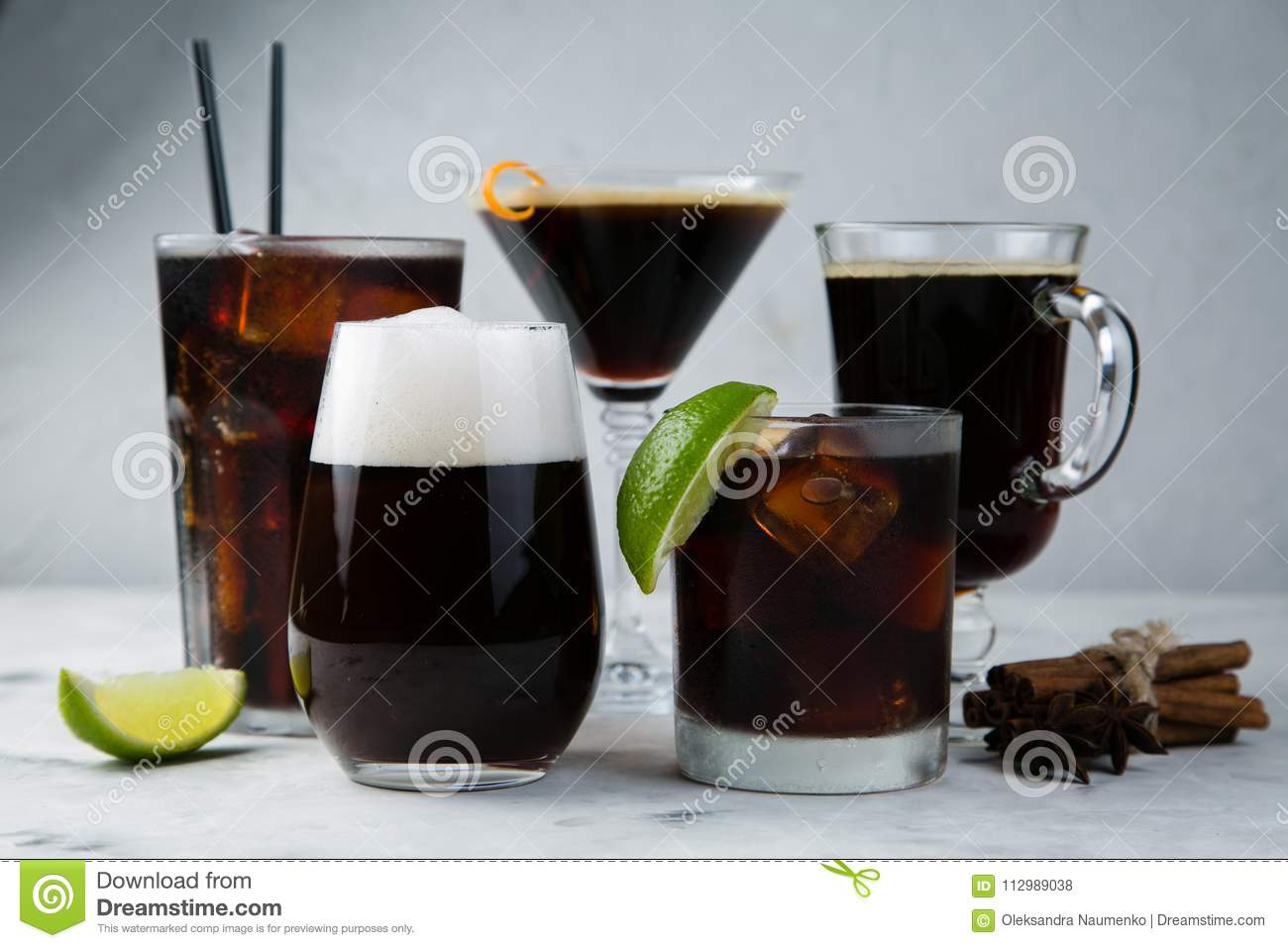 Selection of black cocktails in different glasses, marble background