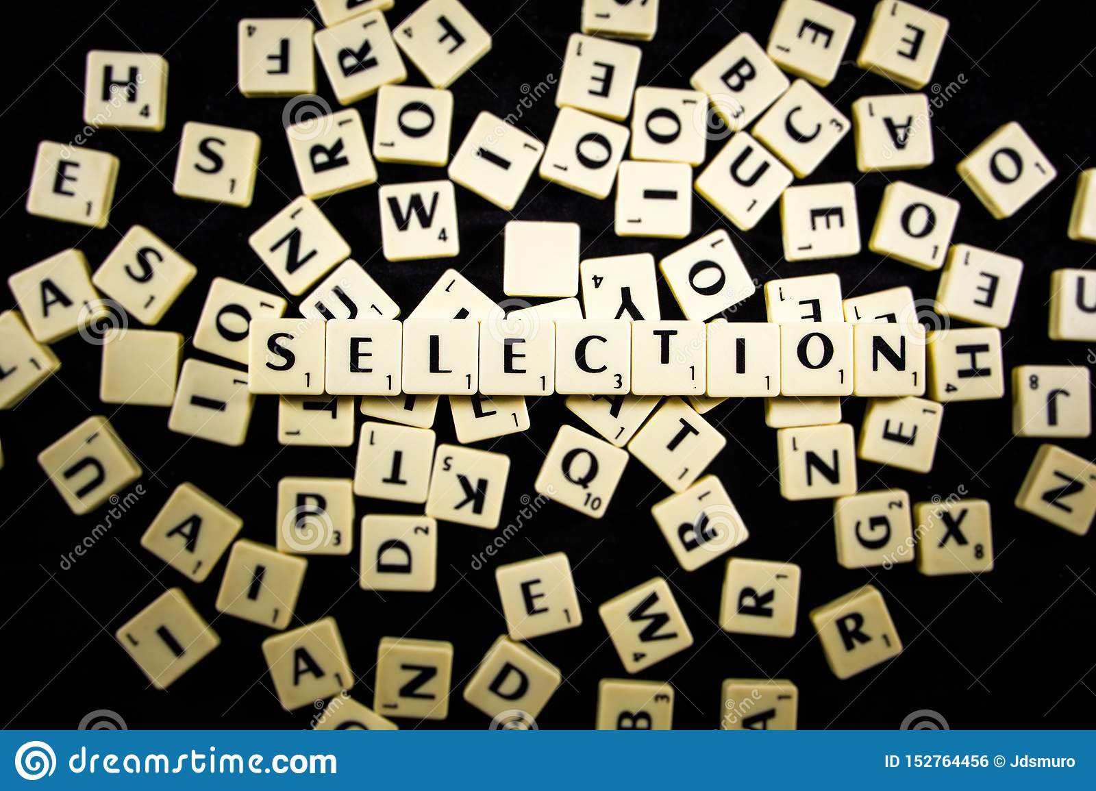 Selection word spelled with letter tiles in black background