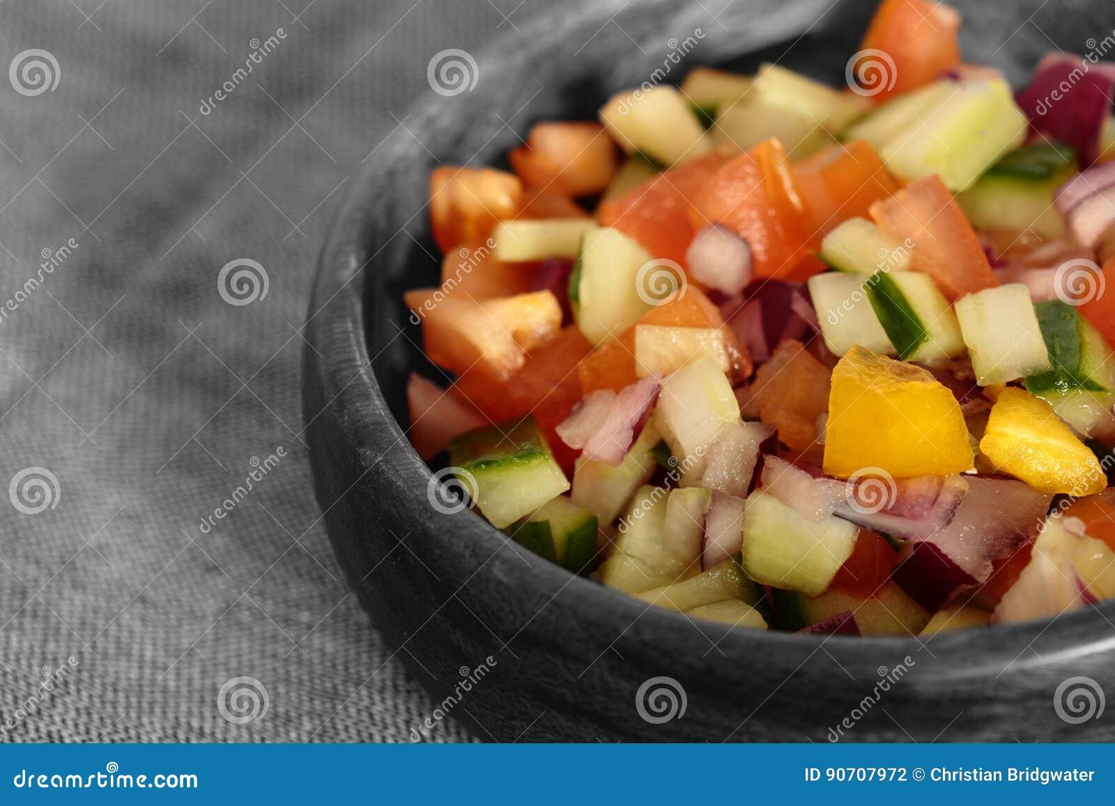 Selective colour image of a salad salsa