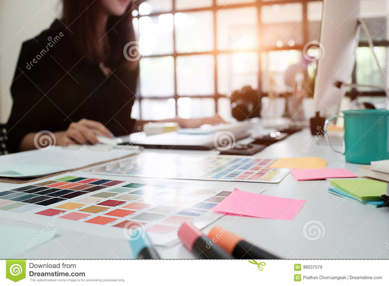 Selective focus on creative table and woman graphic design blur