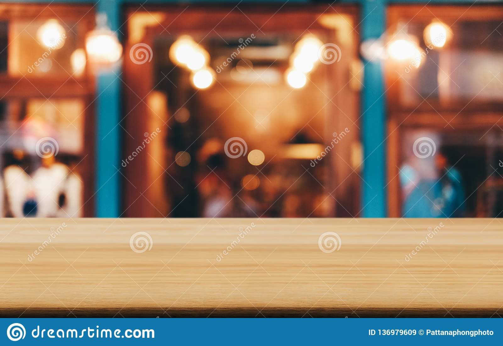 Selective Focus Empty wooden table in front of abstract blurred festive background with night market background bokeh for product