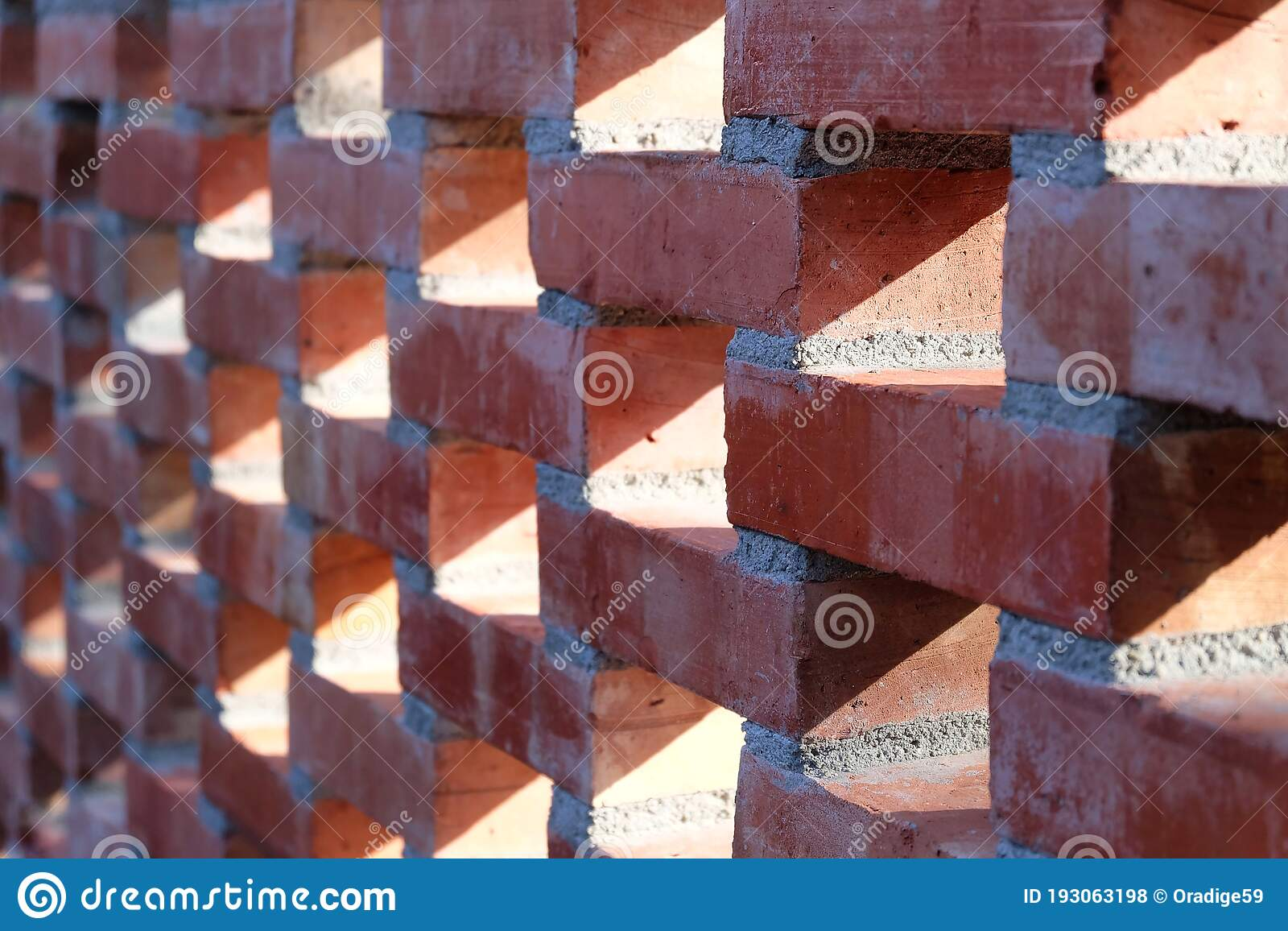 In Selective Focus A Row Of Red Brick Wall With Ventilation Blocks Pattern  Stock Photo - Image of wall, blocks: 193063198
