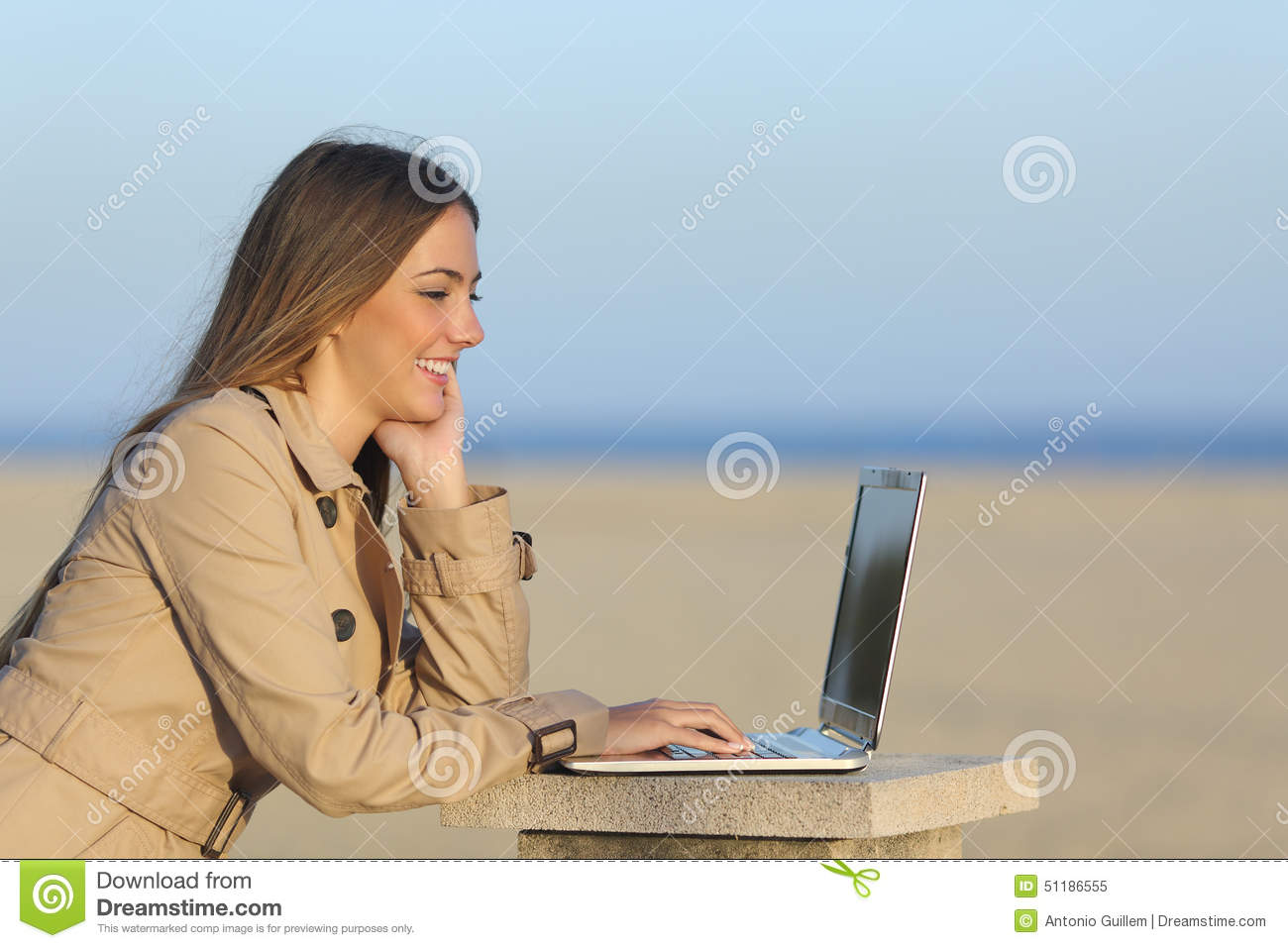 Self employed woman working with a laptop outdoors