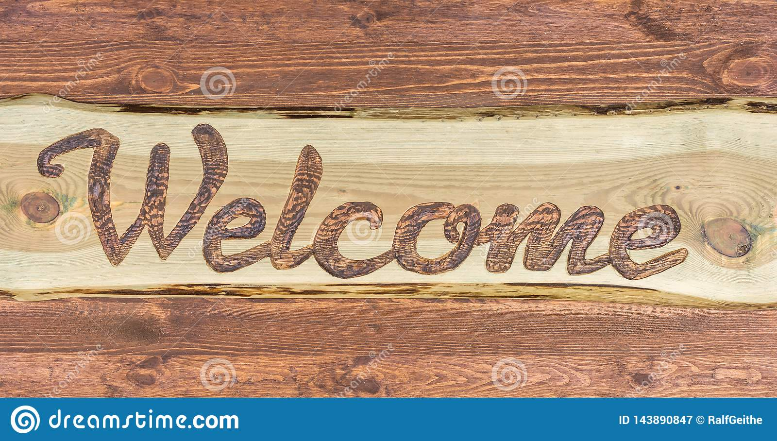 Homemade wooden sign with the english word for welcome
