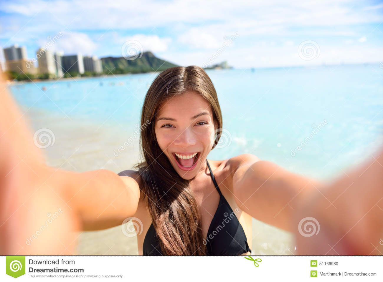 Selfie fun woman taking picture at beach vacation