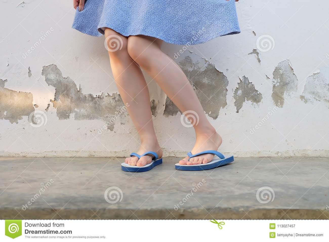 fc1b337fc241 Woman Standing Wearing Blue Flip Flop Sandal on The Cement Floor Background  Great For Any Use. More similar stock images