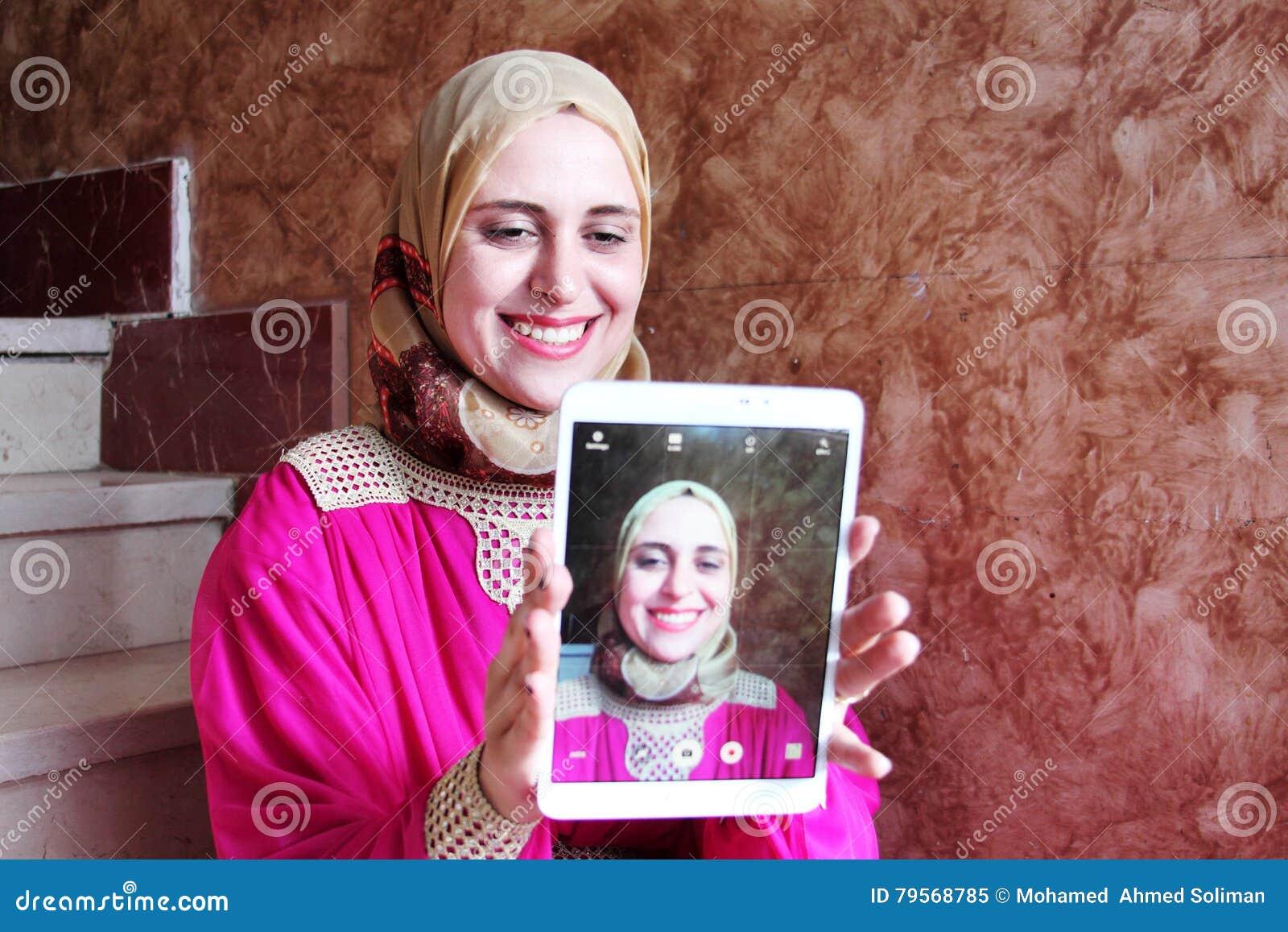 Selfie of happy arab muslim woman wearing hijab