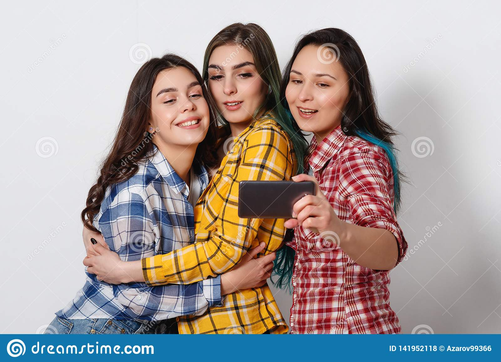 Selfie - Happy teenagers woman taking pictures by themselves on white background