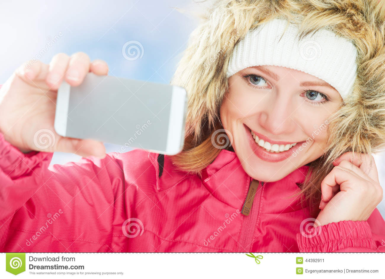 Stock Photo: Selfie, self. happy girl in an active winter holiday ...