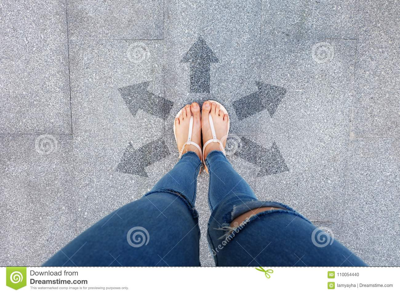 Selfie Shoes with Direction Arrows Choices. Woman Feet and Sandal Standing on Concrete Road Background