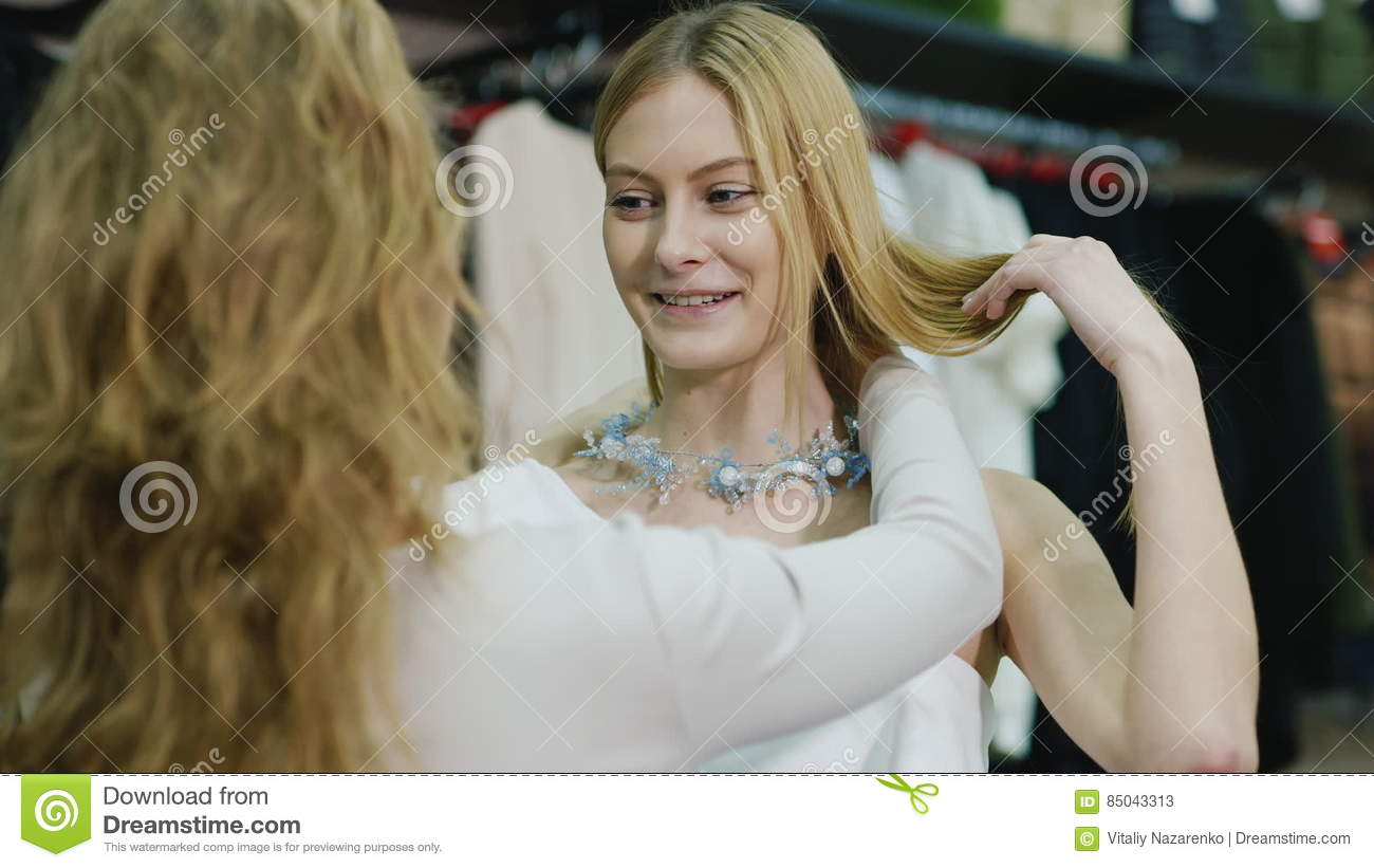 92946f06a Seller Consultant Helps Shoppers To Try On Jewelry. The Department Of Women`s  Clothing And Accessories Stock Video - Video of excited, fashion: 85043313