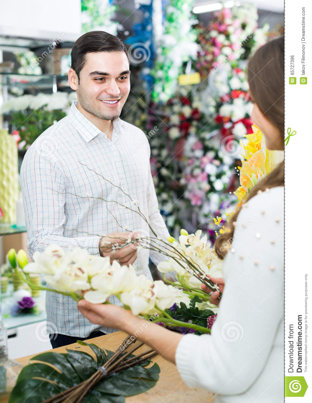 Seller helping to pick flowers man stock photo image of female seller helping to pick flowers man izmirmasajfo Image collections