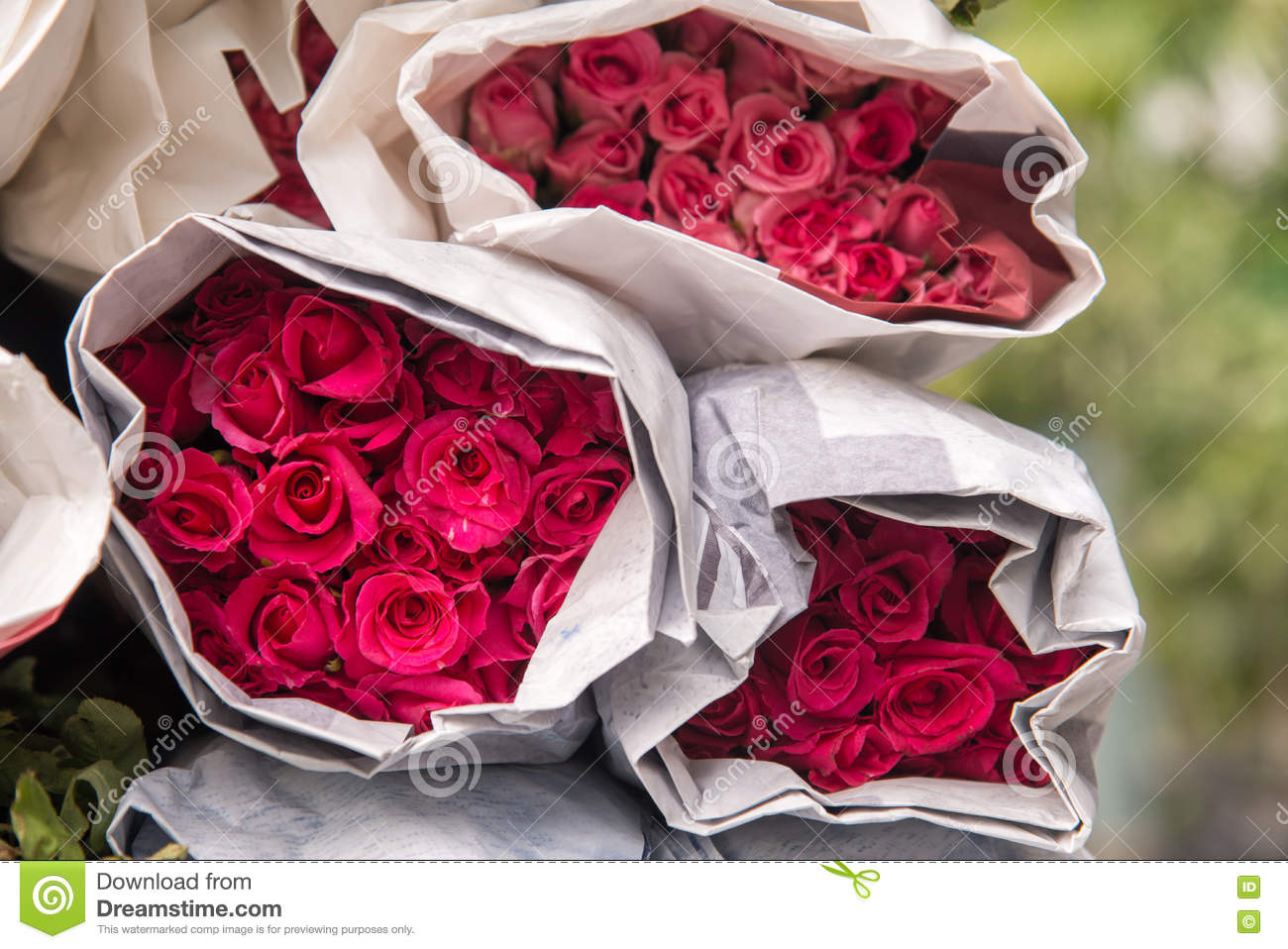 Selling Flowers A Bouquet Of Red Pink Roses Wrapped In Paper