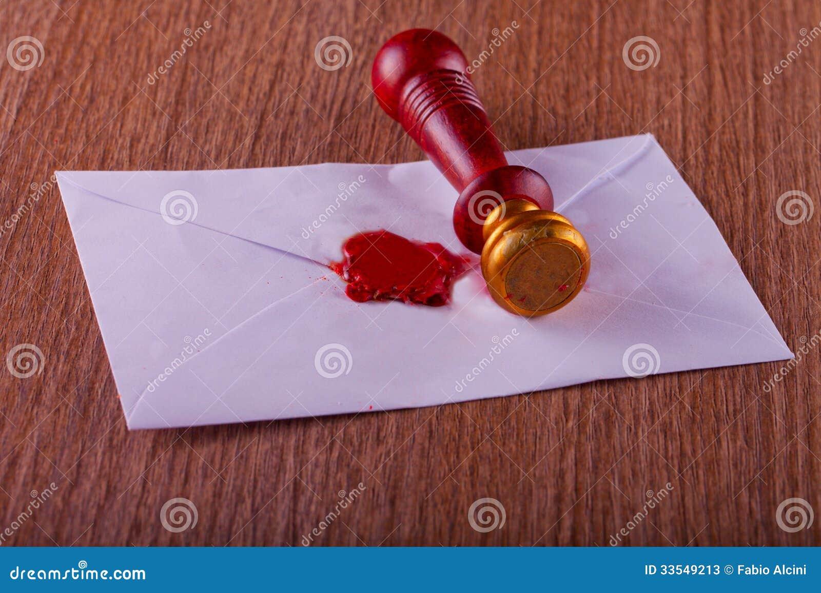 Selo da cera de selagem em uma letra