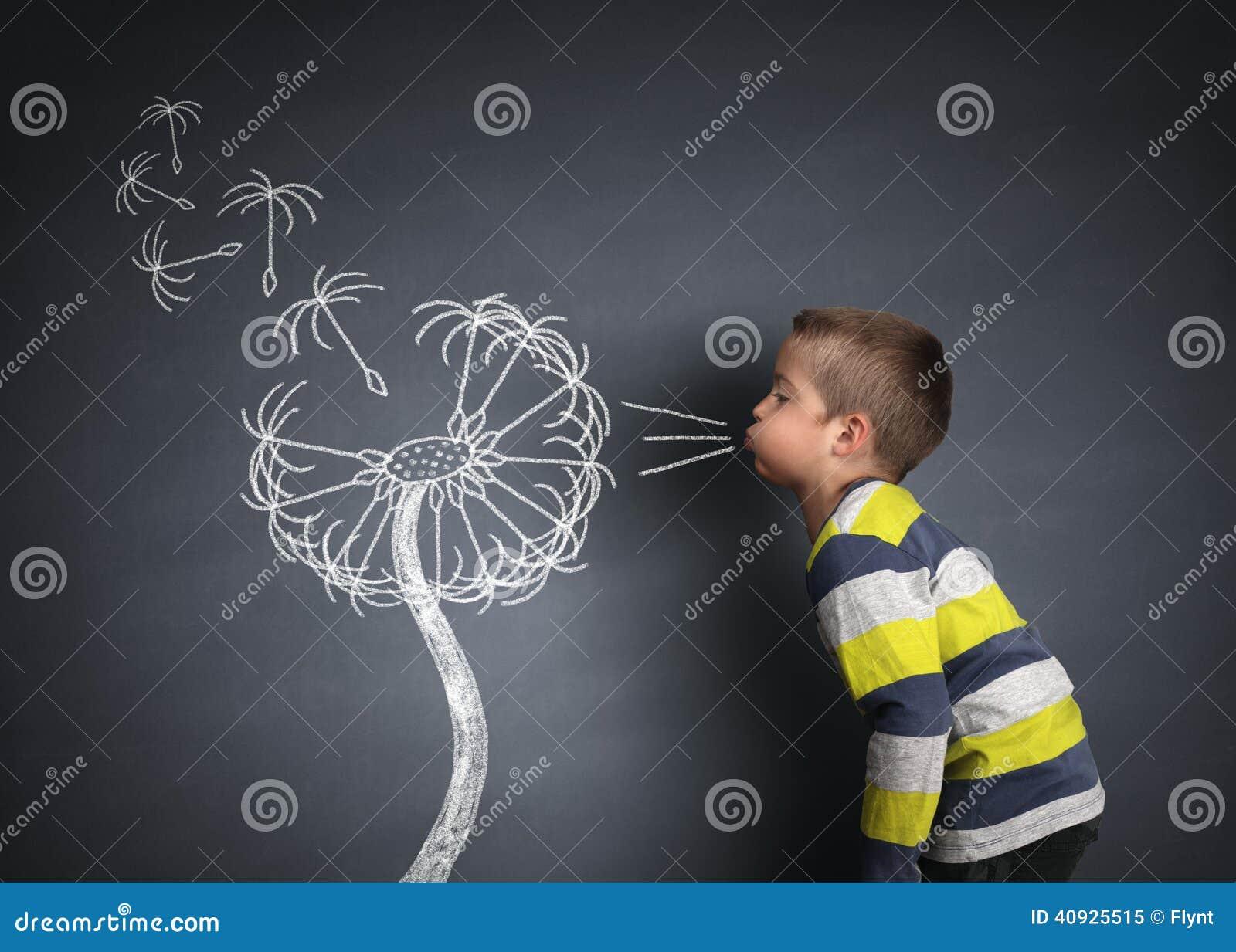 Sementes de sopro do dente-de-leão da criança