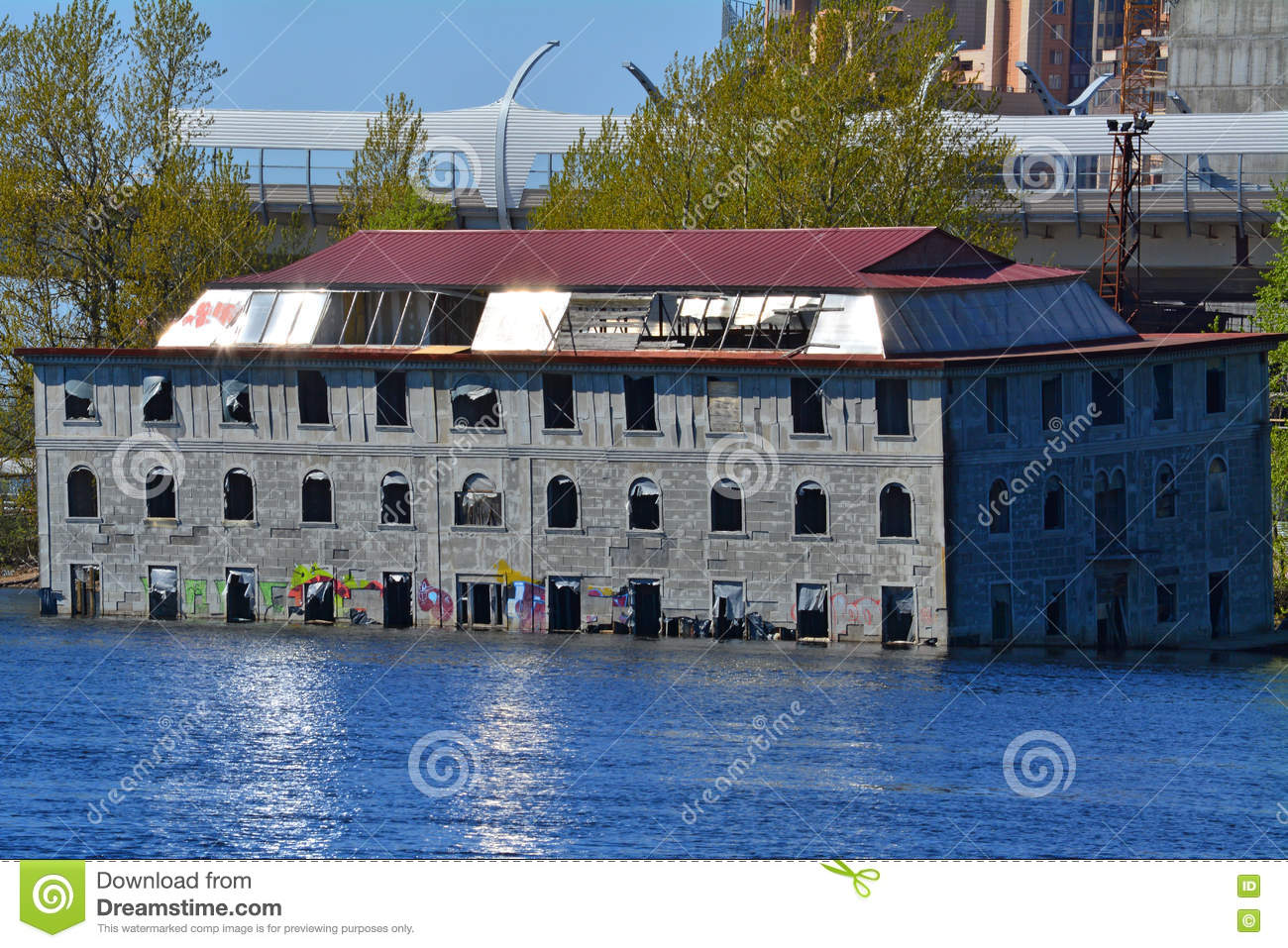 Semi-flooded model of a house on Bolshaaya Nevka River in St. Petersburg, Russia
