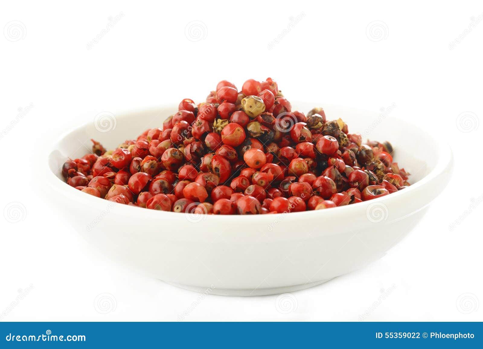 Semi rossi dei granelli di pepe