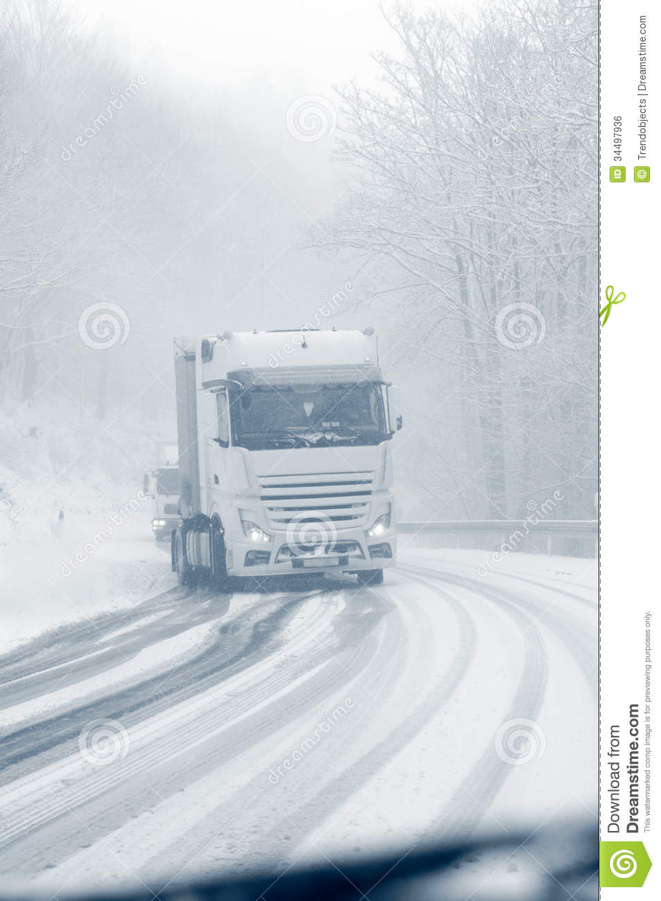 Semi Truck On A Snowy Mountain Road Royalty Free Stock