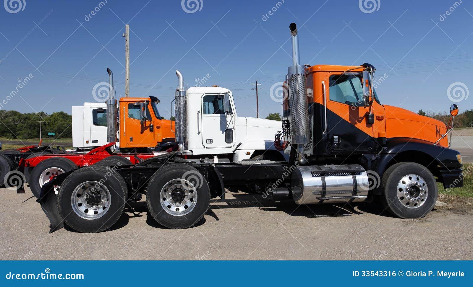 Semi Truck Seats >> Semi Trucks In Orange And White Stock Photo - Image: 33543316