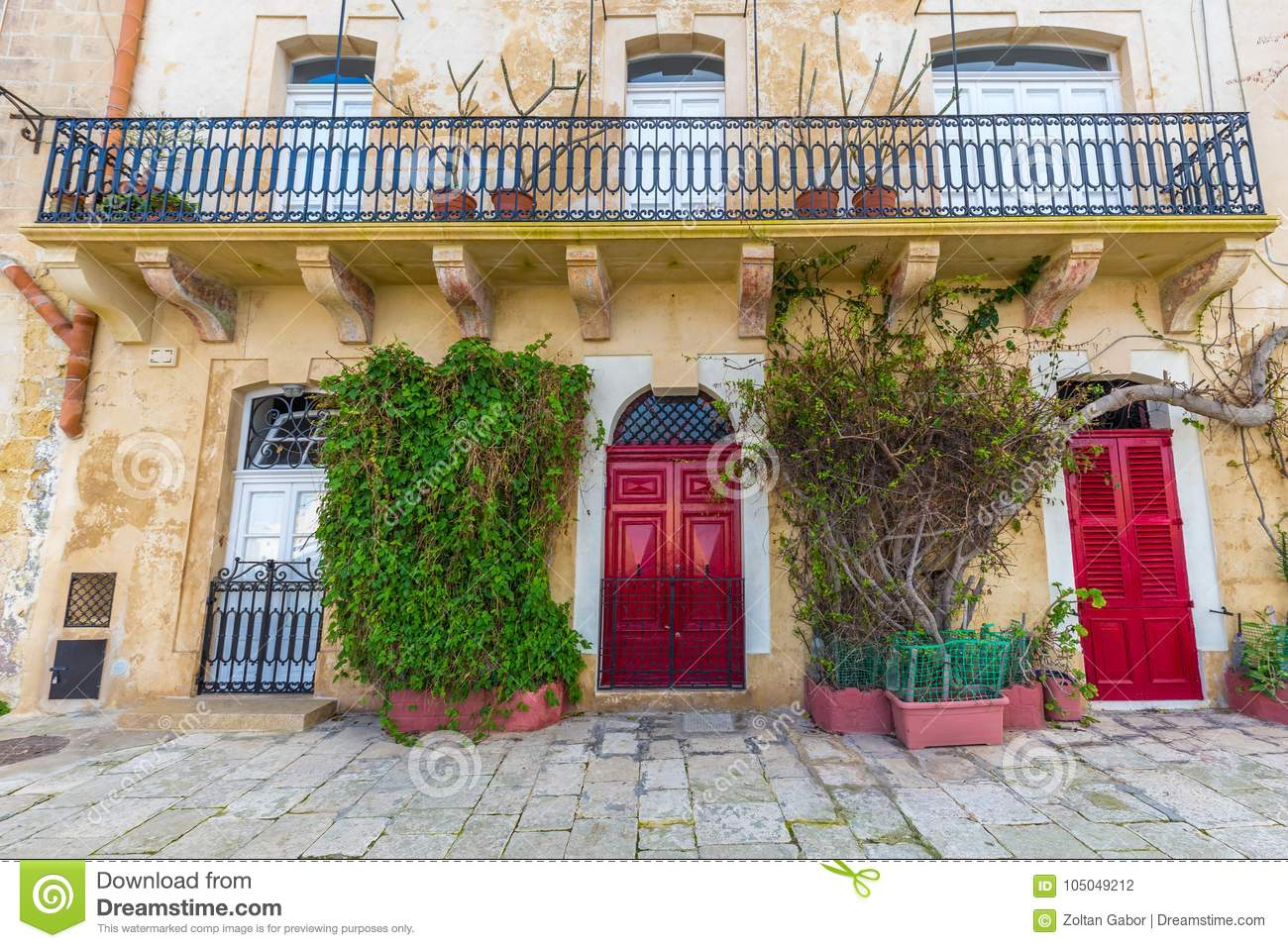 Senglea Malta Traditional Red Doors And Houses On The Streets Of