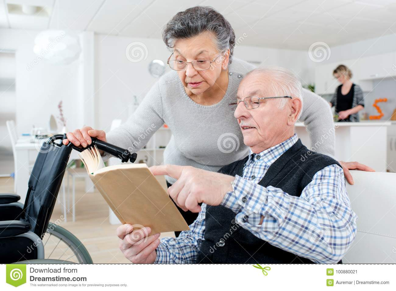 Senior adult couple checking brochure at home