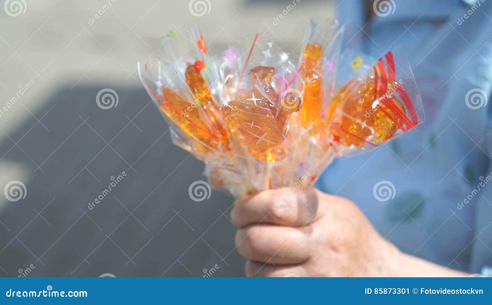 Senior Adult Woman Selling Homemade Lollipops Stock Video