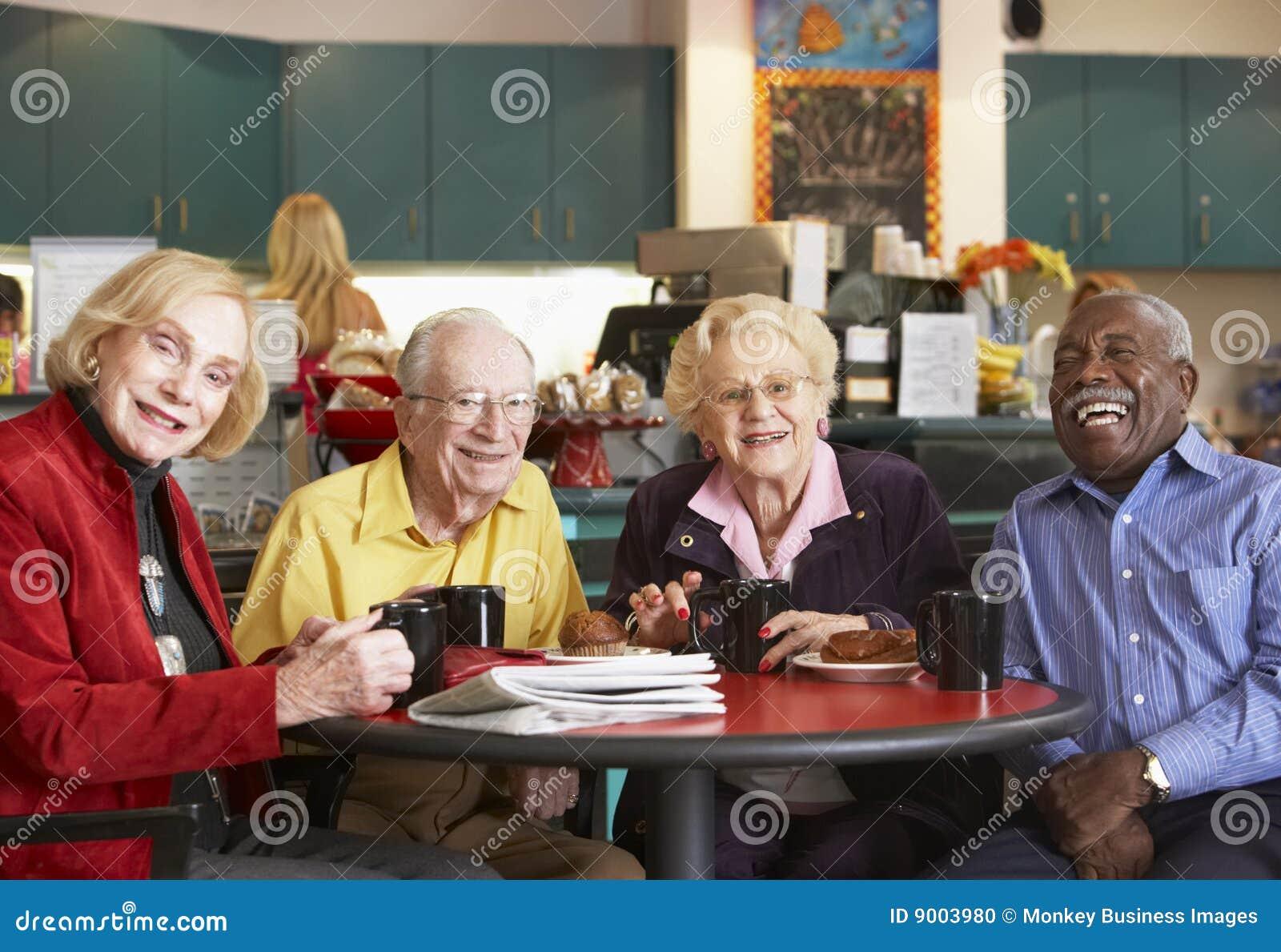 Senior adults having morning tea together