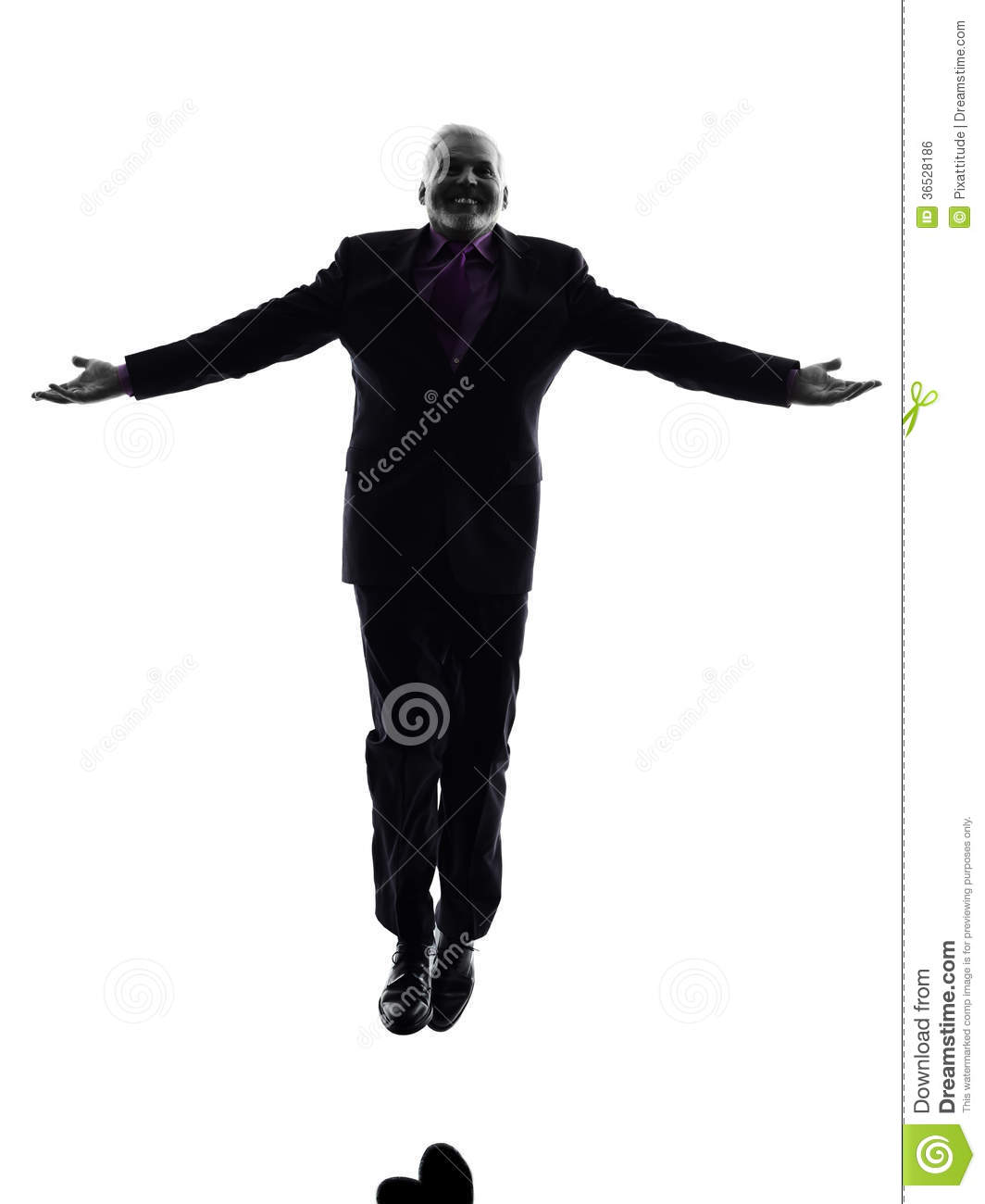 senior business man jumping arms outstretched silhouette stock photo