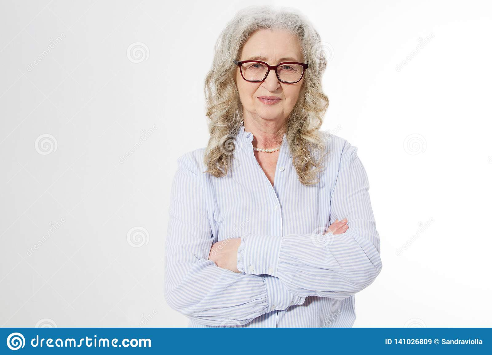 Senior business woman with stylish glasses and wrinkle face isolated on white background. Mature healthy lady. Copy space. Seniors