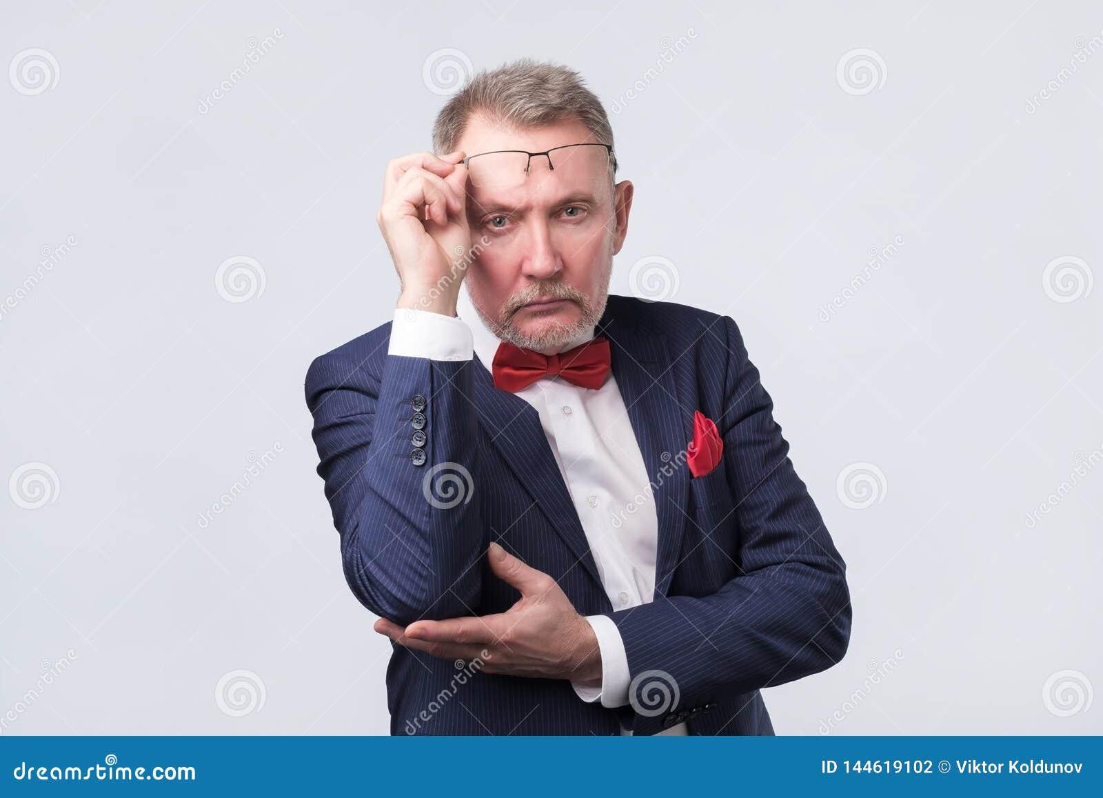 Senior man in blue suit looking confident
