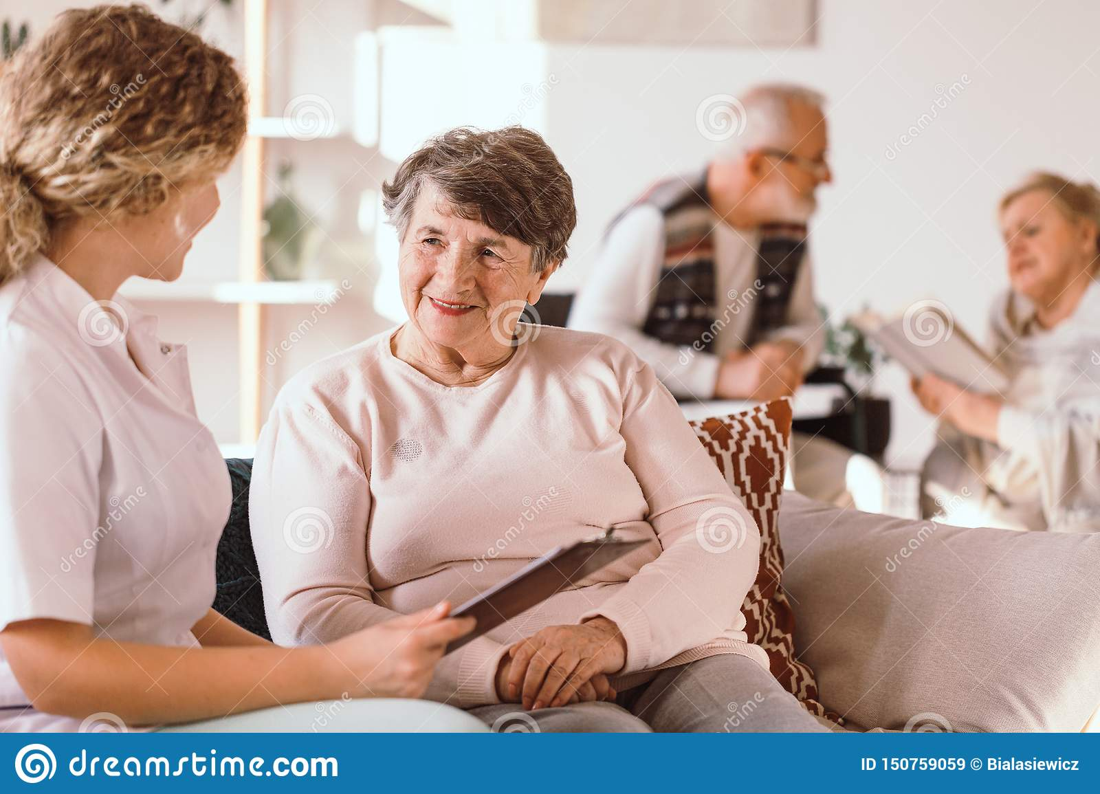 Senior caucasian woman talking with a nurse in the medical facility