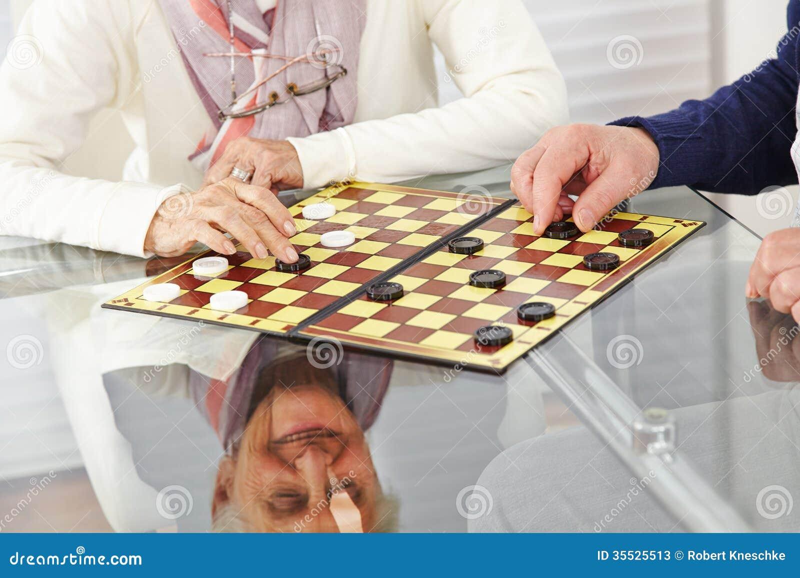Senior citizen couple playing